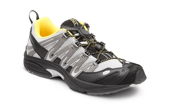 a grey and yellow performance shoe