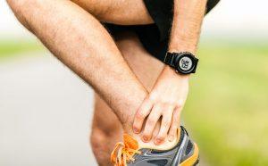 runner holding ankle