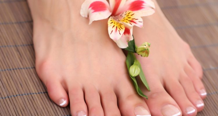 feet with flower in the middle