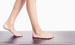 woman walking bare foot