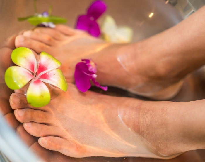 Woman with her feet in water | Mint Foot Care